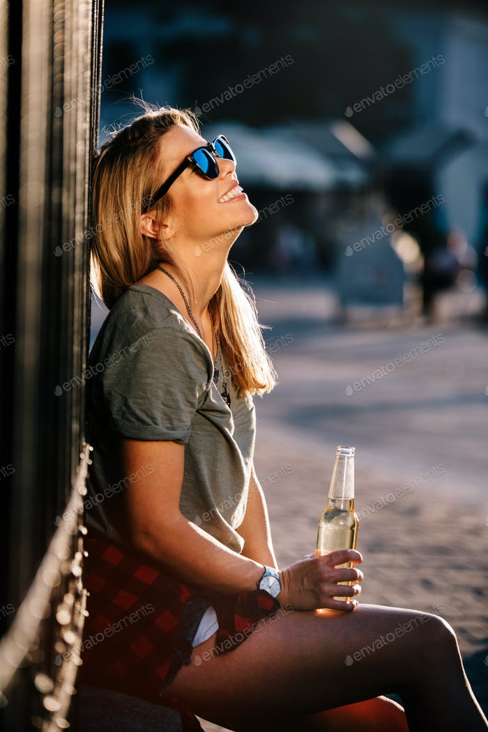 Urban lifestyle, hipster beautiful woman having fun on the street
