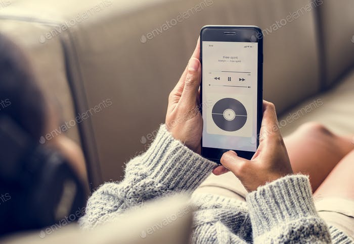 Woman listening to music through the phone