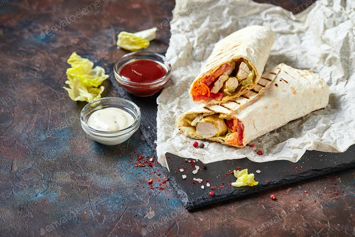 Eastern traditional shawarma with sauces