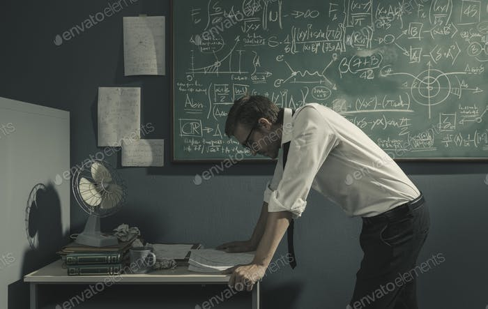 Brilliant mathematician reviewing his work and thinking