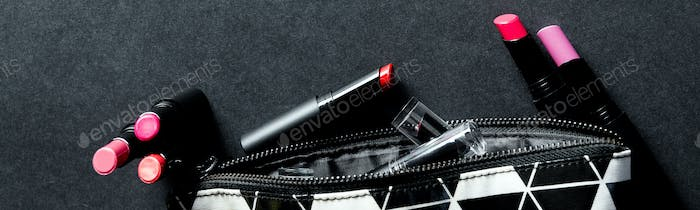 Banner of Black and white make up bag with set of lipsticks.