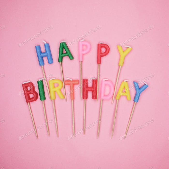 Letter-Shaped Happy Birthday Candles On Pink Background