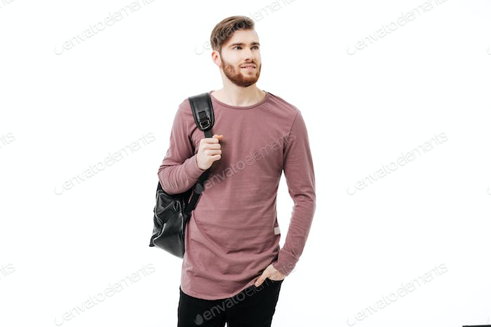 Confident and handsome male student carrying a backpack looking away isolated