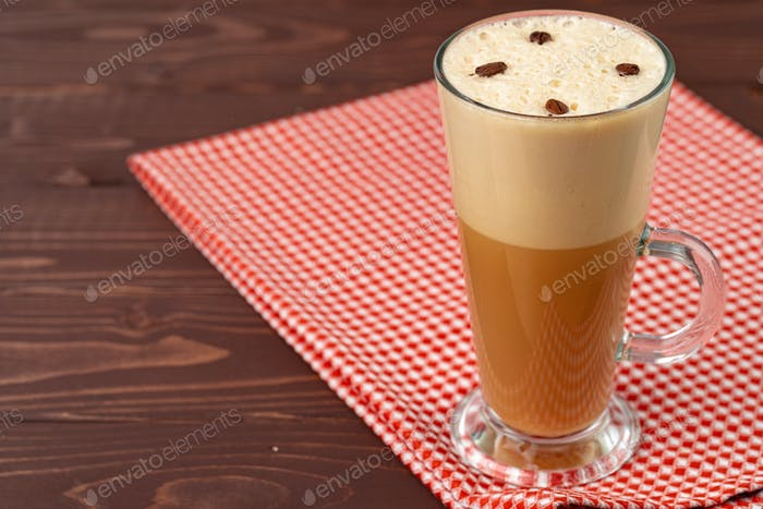 Cup of hot coffee latte on table