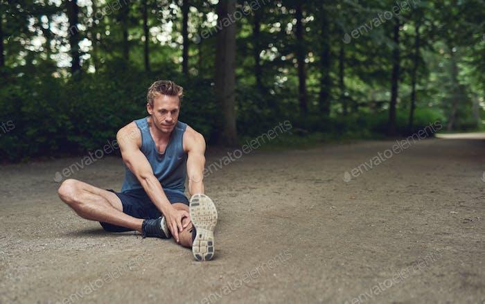 Athlete limbering up before training