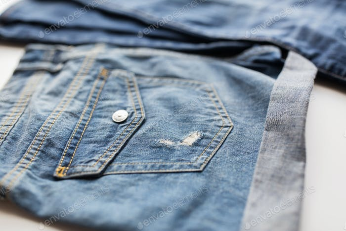 close up of denim pants or jeans with pocket