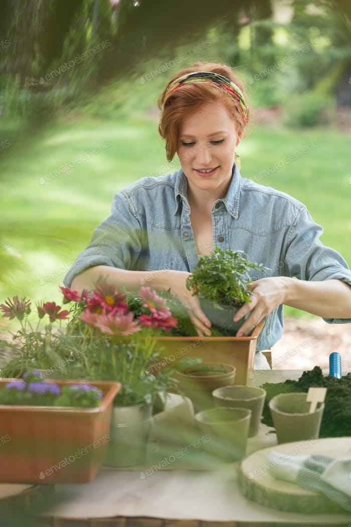 Girl replanting flowers