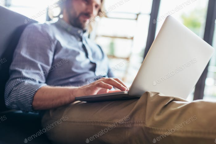 close-up view of middle aged man using laptop