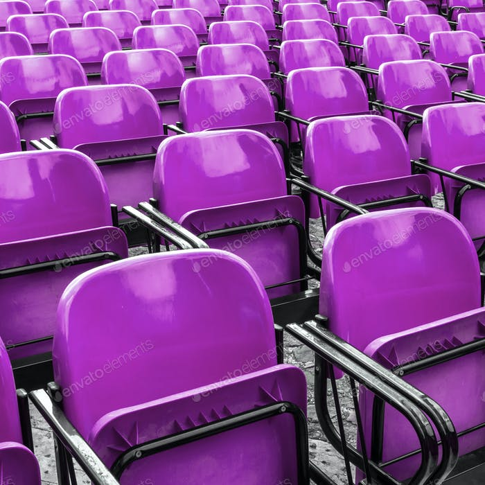 Empty plastic violet chairs