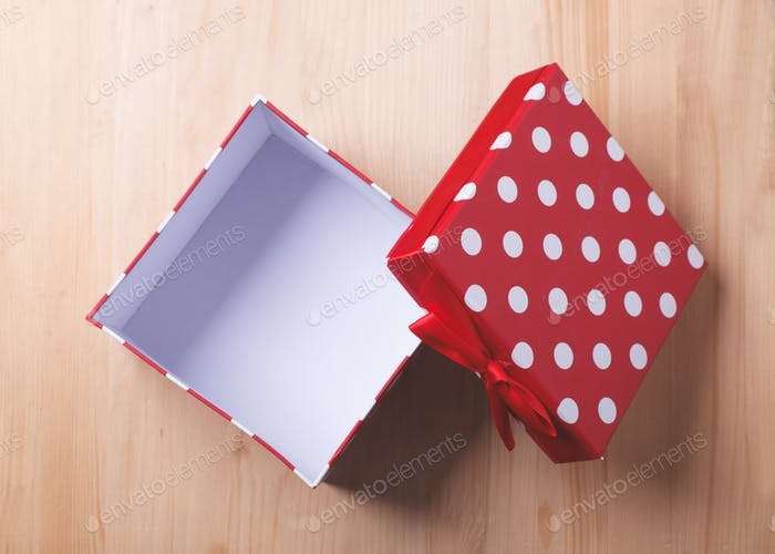 empty red gift box on wooden background