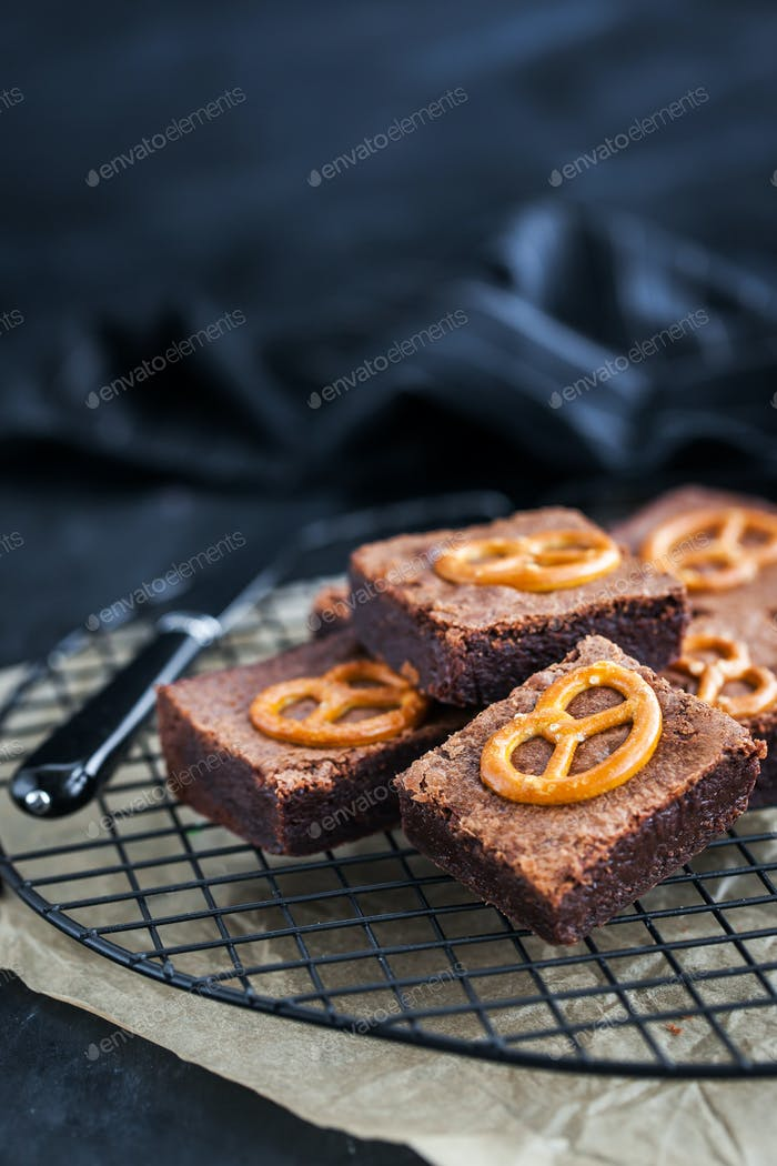 Homemade chocolate brownies with salted pretzels on top