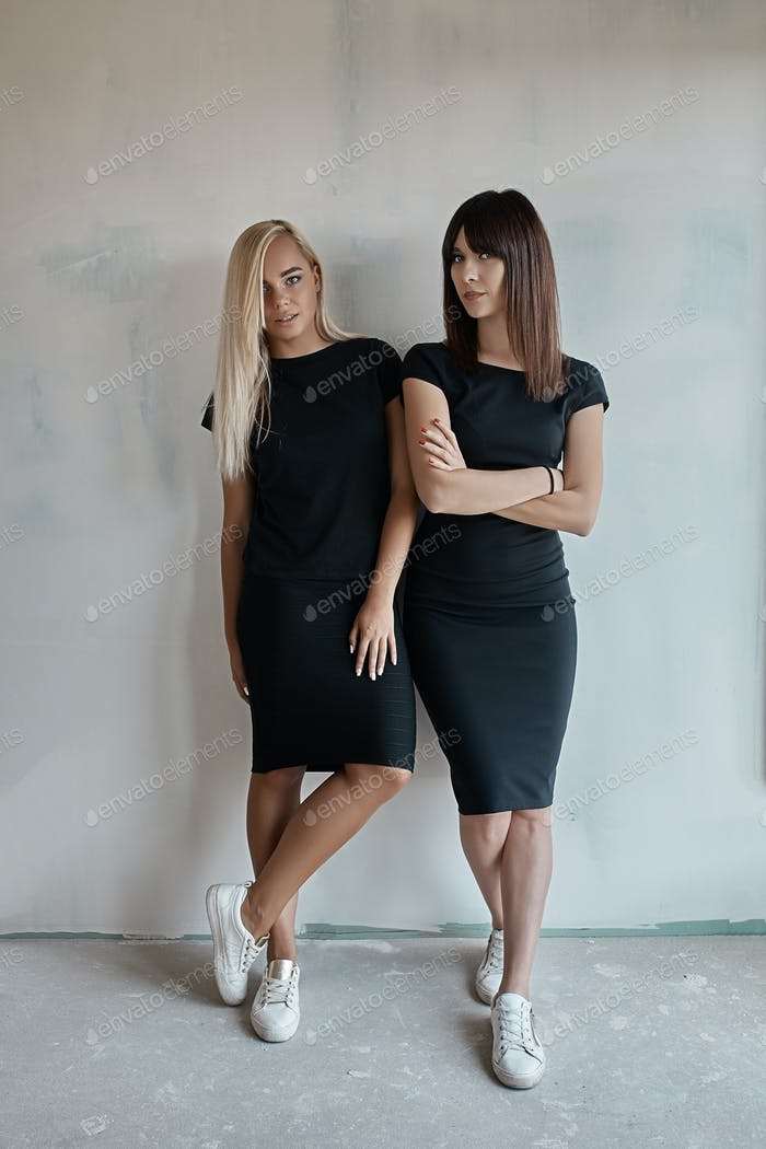Two beautiful women in black dresses