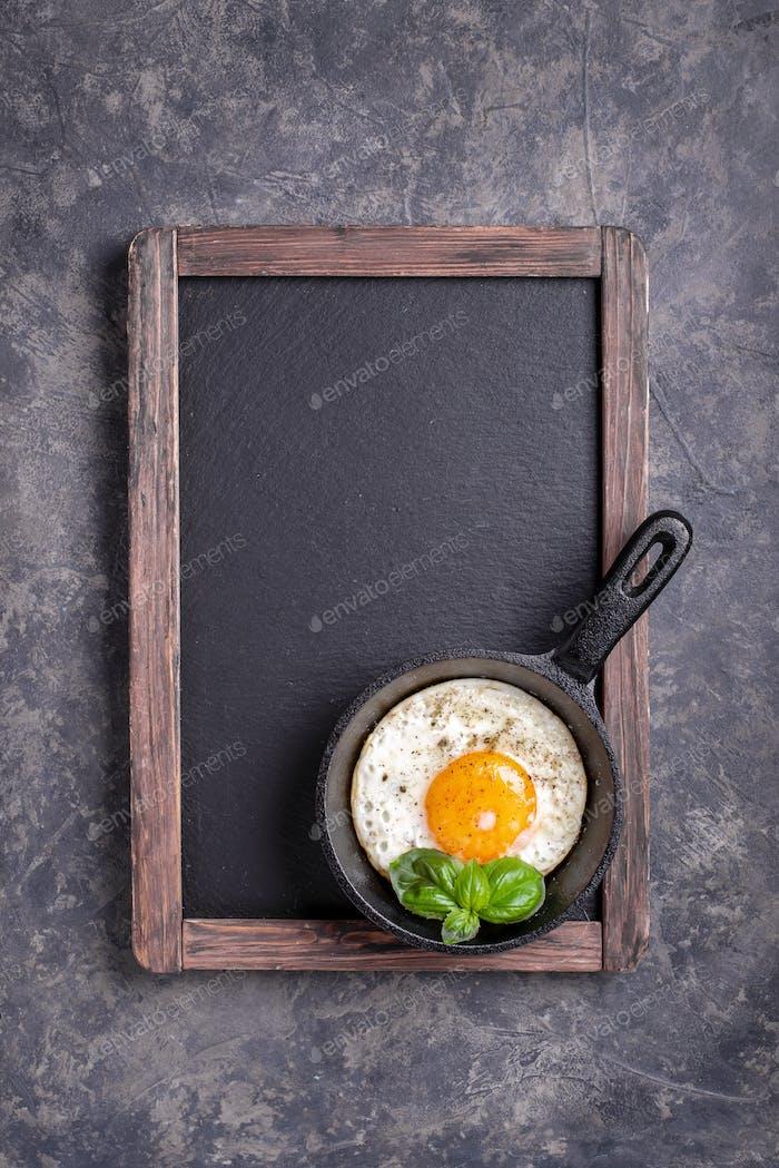 Menu blackboard with egg on pan