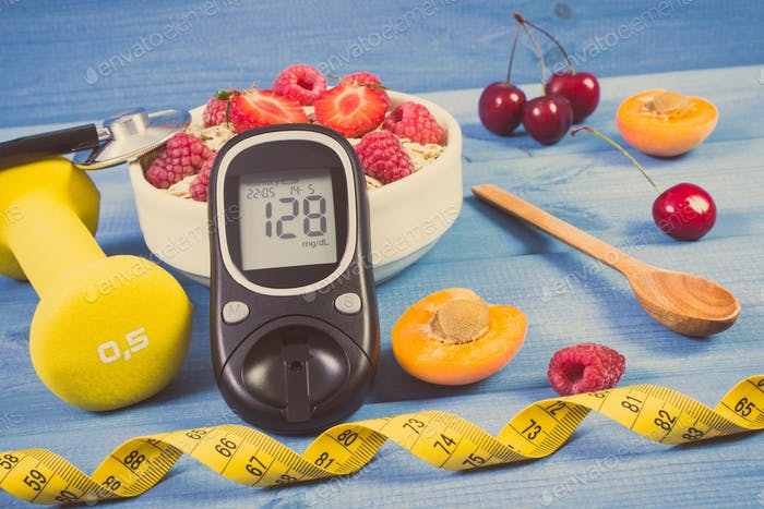 Glucometer with result sugar level, oat flakes with fruits, dumbbells and centimeter