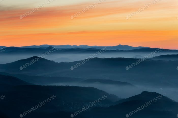 Dramatic sunrise over beautiful mountain peaks. Decinsky Sneznik, Czech republic