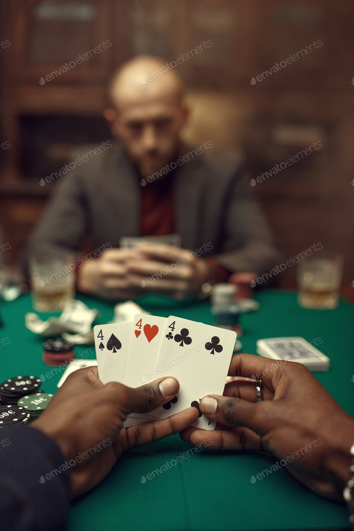 Male hands with cards, poker, games of chance