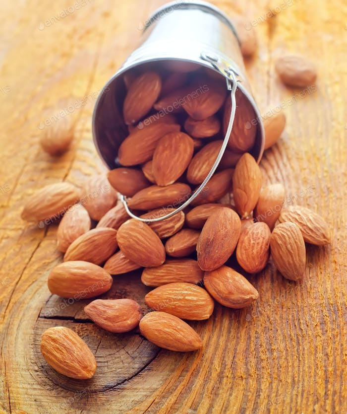 Dry almonds on the wooden board