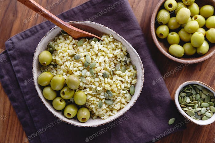 Bulgur with green olives and pepitas