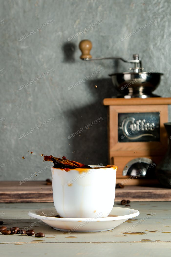 Cup of Coffee with Splash on Wooden Background with Beans.