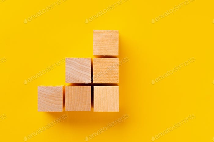 Top view of wooden cubes on yellow
