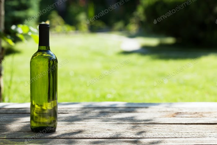 White wine bottle on wooden table