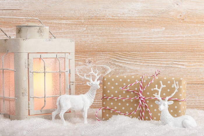 Christmas background with decoration, gift box and candle lantern