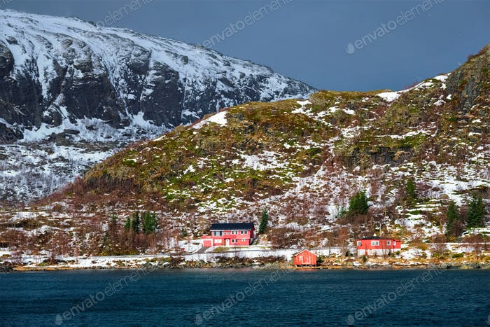 Red rorbu houses in Norway in winter