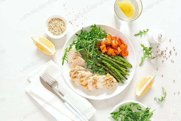 Grilled chicken breast, fillet with butternut squash or pumpkin, green beans and fresh arugula salad