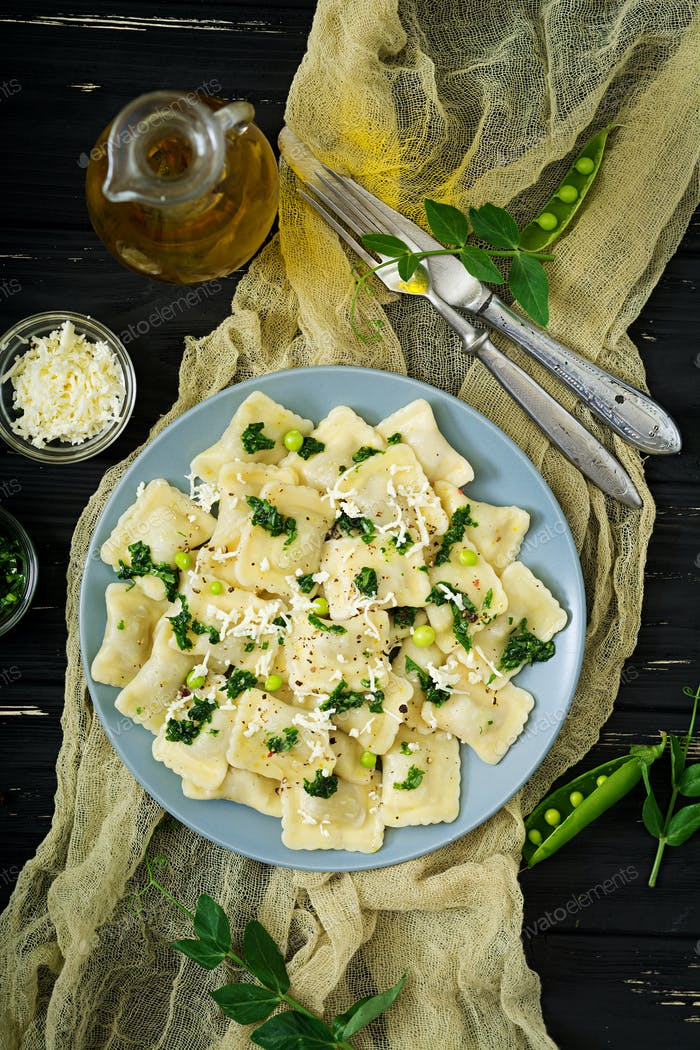 Ravioli with ricotta and young green peas. Flat lay. Top view