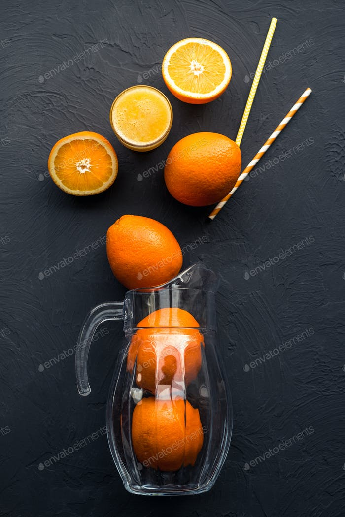 Fresh juicy oranges on wooden table