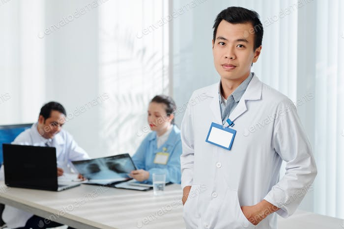 Young confident Vietnamese doctor