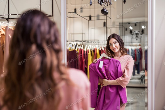 Young attractive woman at the mirror