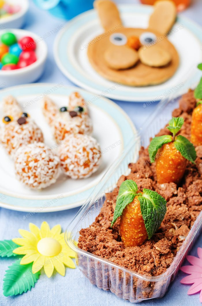 Easter background with sweets and juice for kids