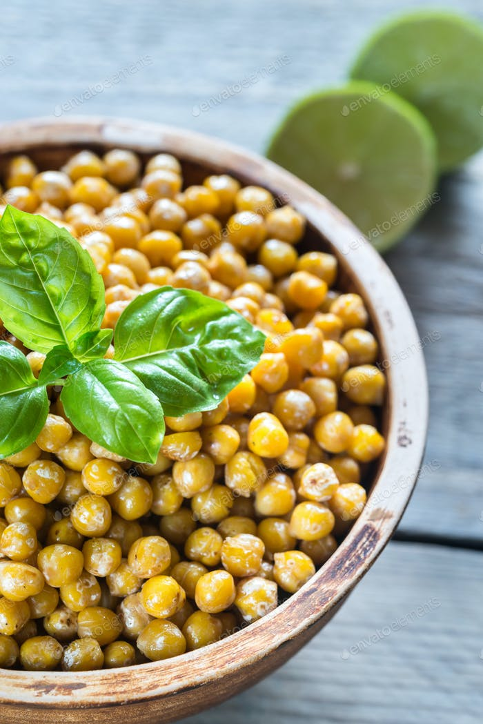 Thumbnail for Bowl of roasted chickpeas on the wooden background