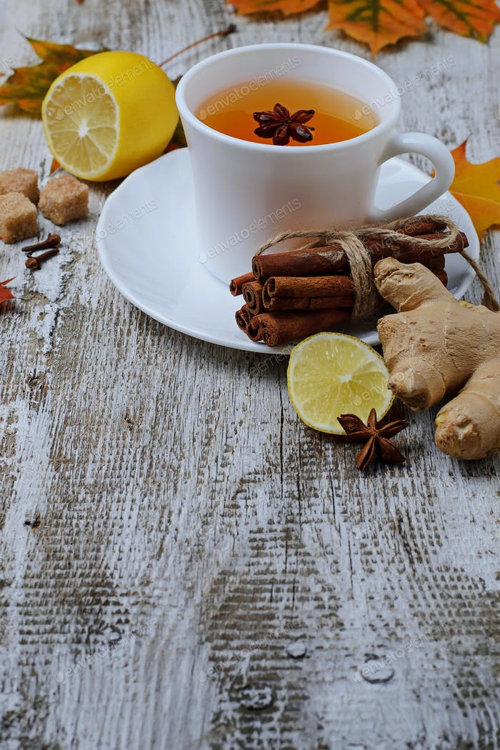 Ginger, lemon and cop of tea on light background