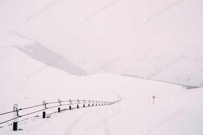 Snowy Empty Free Road In Winter Hills Mountains Landscape, Georg