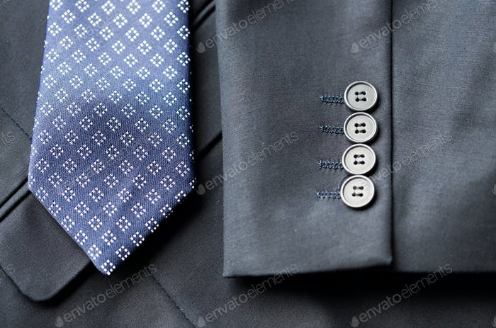 close up of business suit jacket and tie