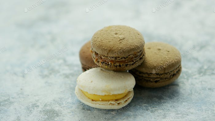 Delicious macarons pastries on marble
