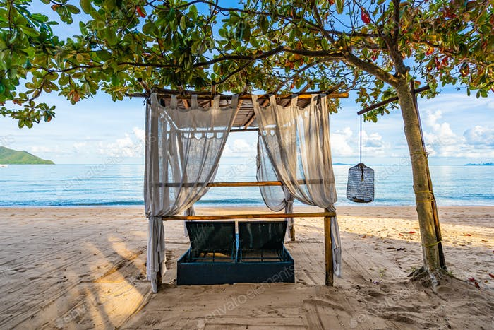 Empty bed chair and lounge on the tropical beach sea ocean with
