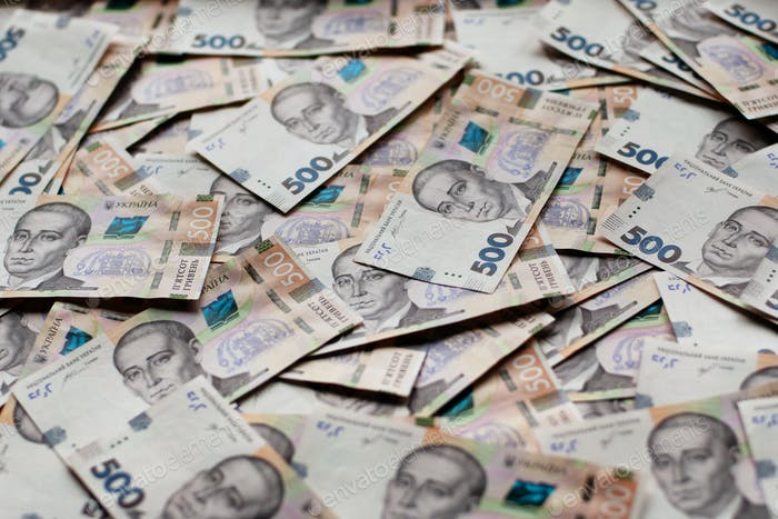 Ukrainian paper money bills of hryvnias financial background. Savings or expence concept
