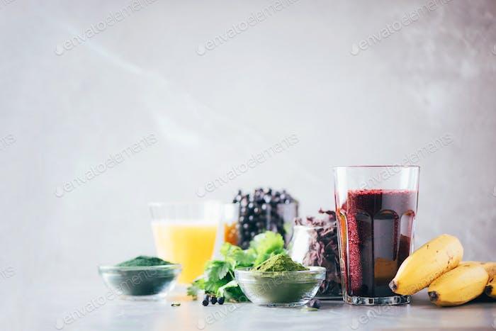 Healthy eating, alkaline diet, vegan concept. Blueberries, bilberry, barley grass juice, spirulina