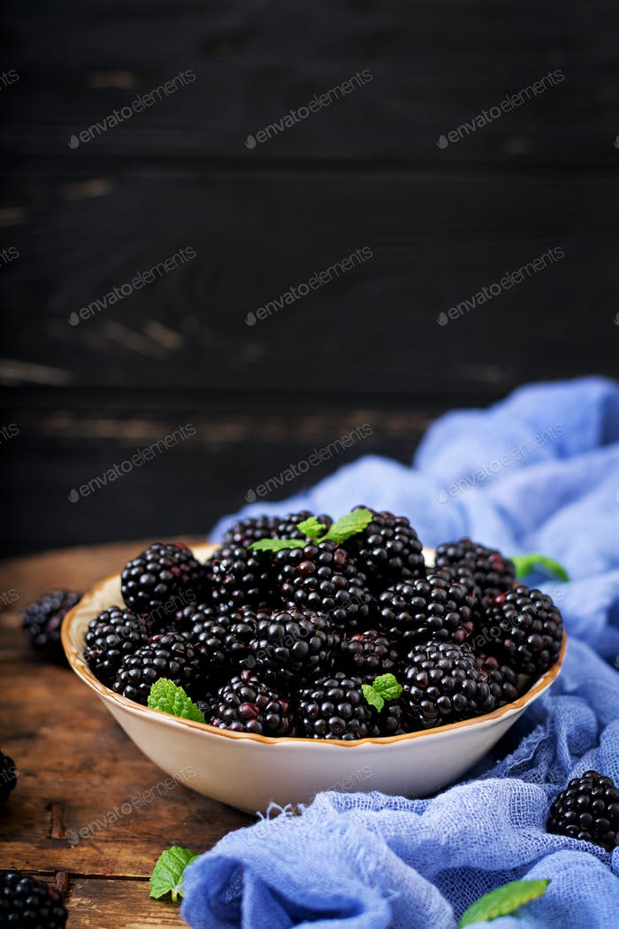 Summer berry on table. Healthy lifestyle concept, blackberries in bowl.