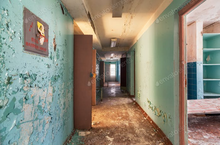 Corridor with open doors in an abandoned old building