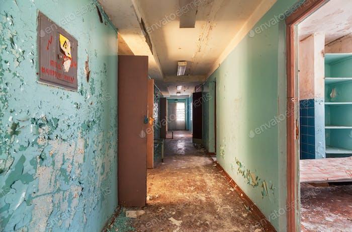 Corridor with open doors in an abandoned old building