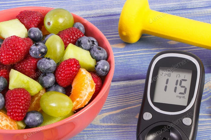 Fruit salad, glucometer for checking sugar level and dumbbells