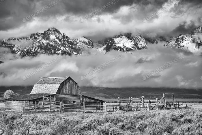 Black and white Teton mountain range with Moulton Barn in Grand