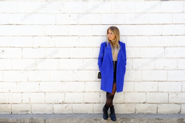 The girl in the blue coat on the street