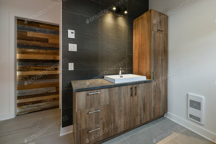 Modern bathroom with barn wood sink cabinets