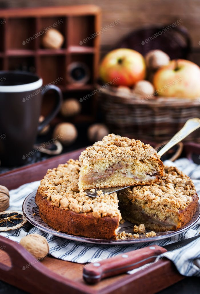 Piece of fresh homemade apple and cinnamon crumb coffee cake