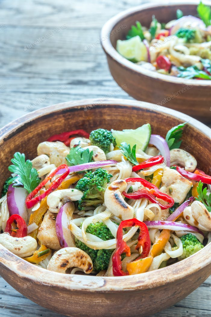 Two bowls of chicken noodle stir-fry